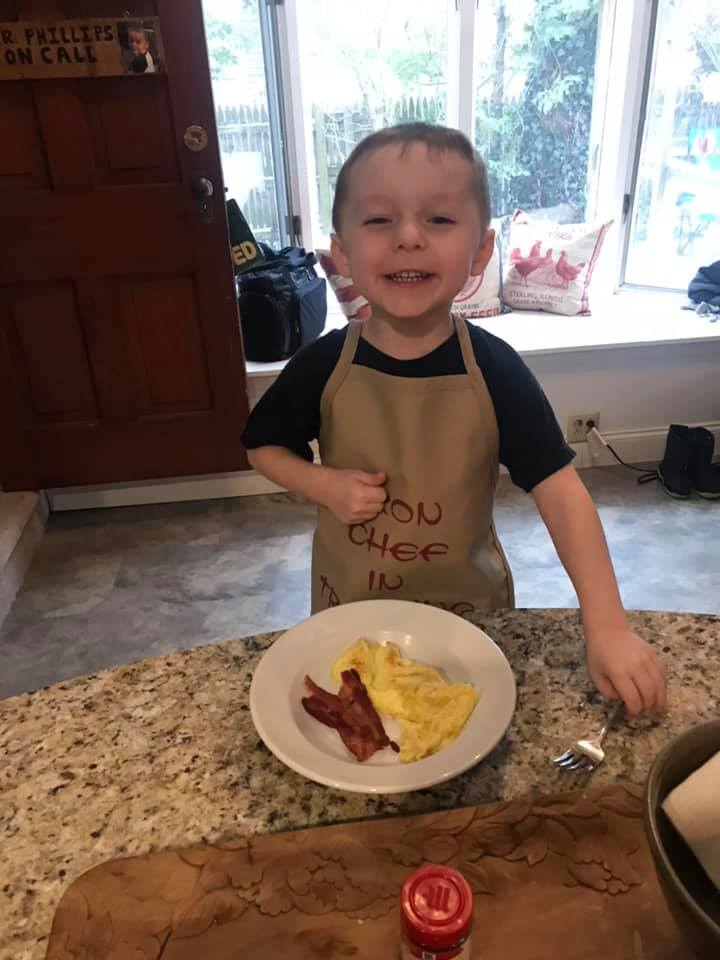 The little chef is ready to eat.