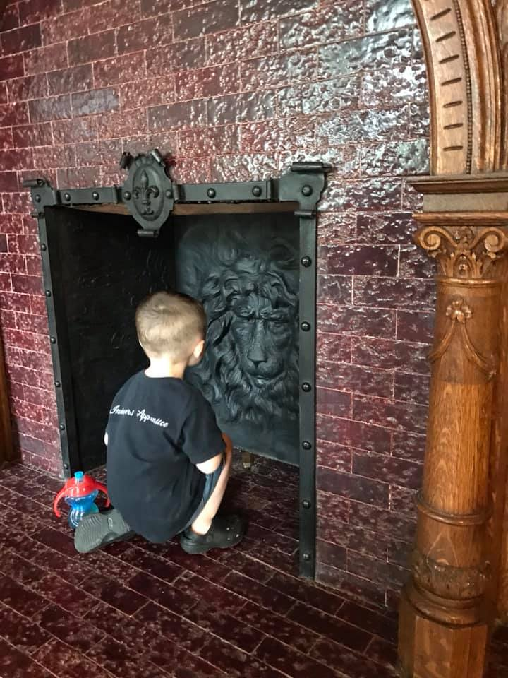 Checking our antique fireplace.